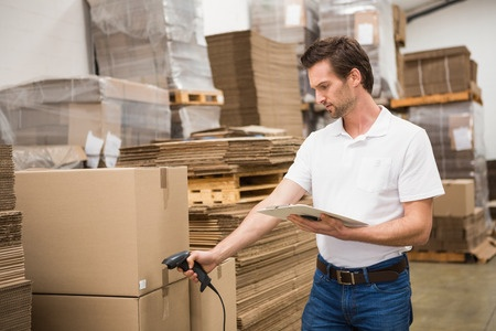 Man scanning package in warehouse